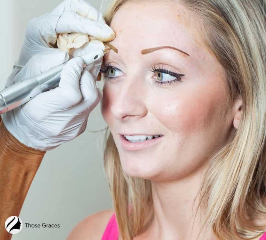 lady getting permanent brown tatooo eyebrows
