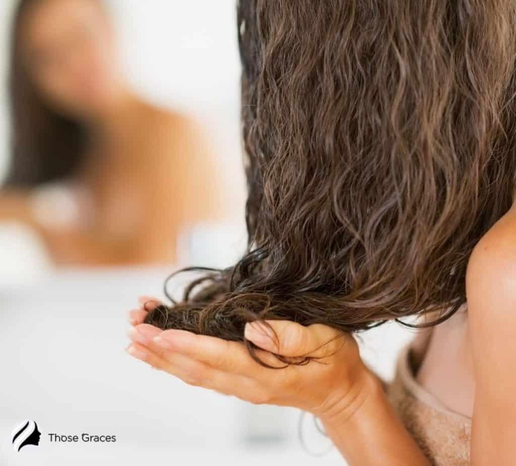 woman putting Olaplex to her wet hair but Is Olaplex Good For Fine Thin Hair