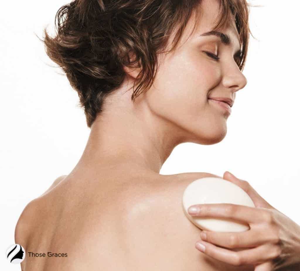 short-haired lady using an antibacterial soap for body