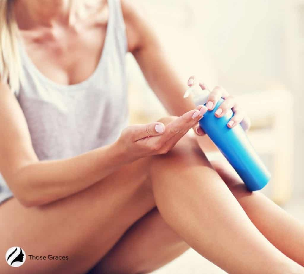 woman pushing the lotion bottle