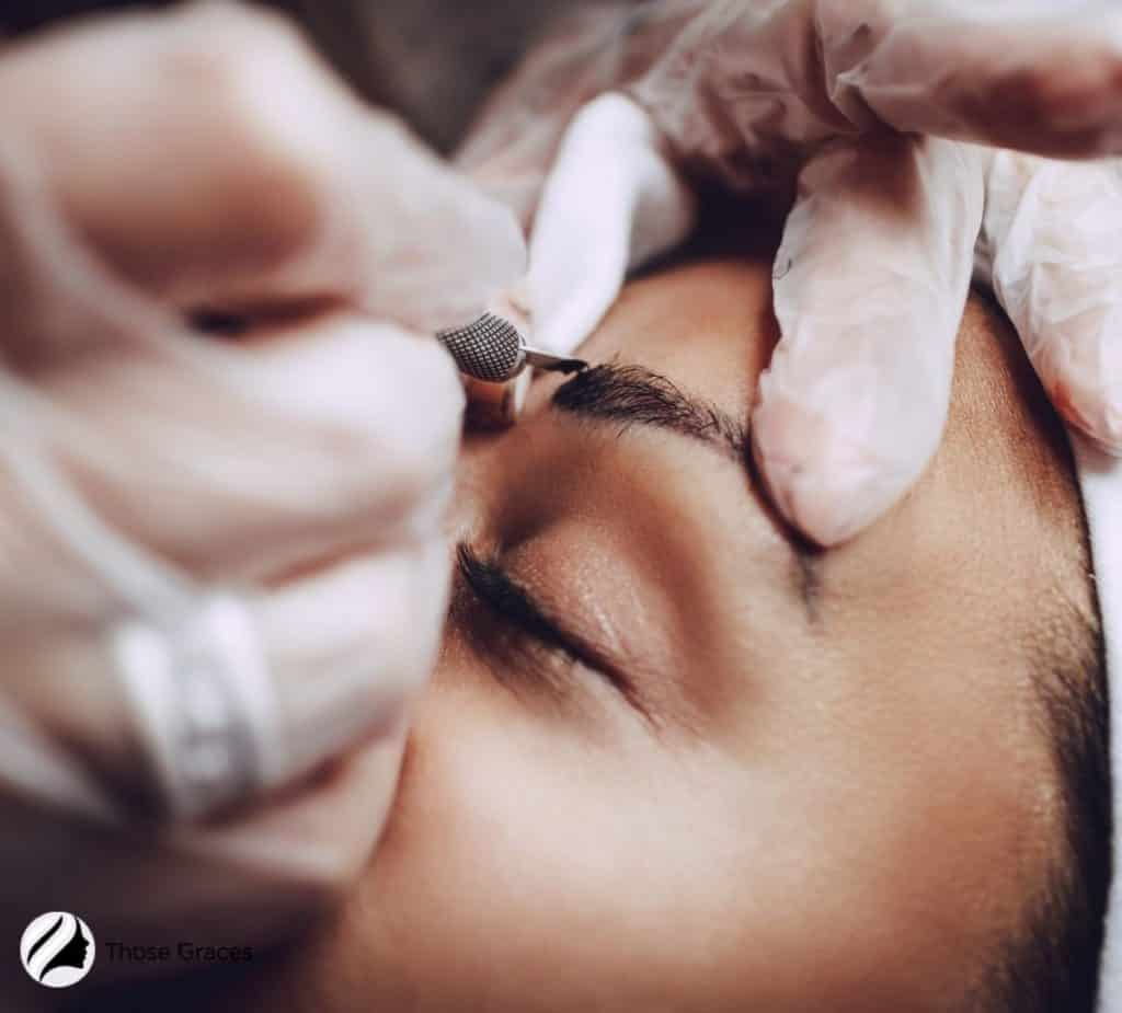 woman getting a microblading session for her brows: but what's the difference for eyebrow tattoo vs microblading