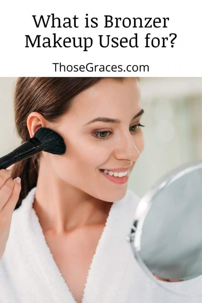 pretty lady adding bronzer to her cheekbones