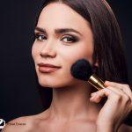 lady using makeup bronzer