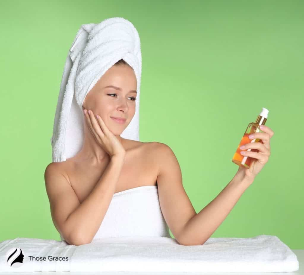 smiling lady holding an oil-based cleanser