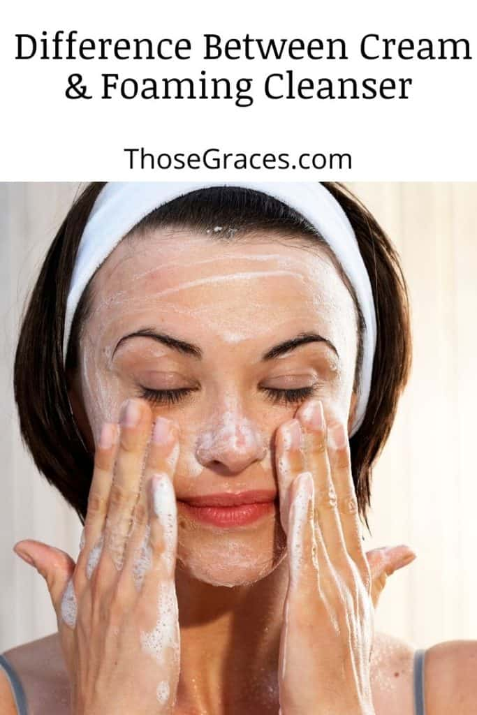 woman with white hairband washing her face with cream cleanser