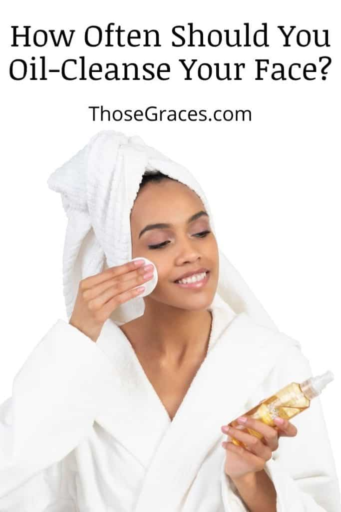 lady cleaning face with oil
