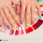 hand surrounded by colorful press on nails